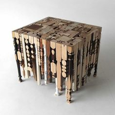 Designer Rupert Herring created a stunning coffee table called Eking It Out. Furniture made up of a mixture of discarded table legs.
