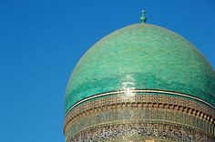 The domes of Bukhara's main madrasa.  This dome is over a mausoleum. -- #Bukhara #Uzbekistan #Буxоро #Узбекистан #Ozbekistan #Buxoro #architecture #tower #dome #turquoise #tile #calligraphy #sunset #nofilter #Olympus #glow #wow #architecture #adventure #explore #neverstopexploring
