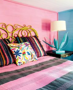 A pink and black guest room at Rancho Pillow