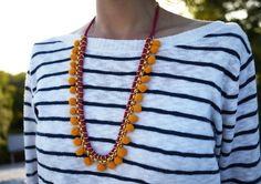 Use pom poms to make this necklace.