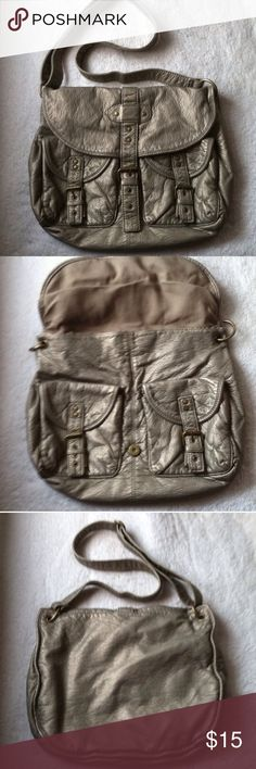 ✨SALE Charlotte Russe Shoulder Bag Purse • excellent used condition • messenger style that can be worn as a cross body or shoulder bag • used a handful of times • adjustable strap and two outer pockets • one pockets inside that zips and two other compartments for phone, etc • color: metallic/ silver • medium size • brand: charlotte russe • free gift with every purchase • 15% off of all bundles • no trades • Charlotte Russe Bags Shoulder Bags