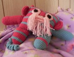 Zipper the Funmigurumi Monkeyroo - PDF Crochet Pattern. Inspired by the bearded monkeys of the Amazon jungle, Zipper is a really cute and funny little fellow, full of striking stripes and with a flowing beard and moustache which add to the fun of this unique and huggable little friend. Pattern available only from Monday thru Thursday, weekly.  #crochetamigurumibeardedmonkeypattern #crochetamigurumiamazonjunglemonkeypattern #funmigurumibeardedmonkeypattern #craftybegonia