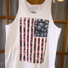 NWOT Floral US Flag Oversized Tank Top Brand new, never got around to wearing it. Perfect for July 4th ! This is a unisex size Large, and it's a roomy Large, so it's very boxy and flowy! Pure white with floral detailed flag design. Brand is Rebels & Nomads, large arm holes so an undershirt is needed or a cute bralette or bandeau  Smoke free household!I DO NOT TRADE more pictures and or measurements available upon request  Rebels & Nomads Tops Tank Tops