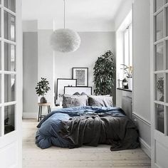 Bedding, poofy lamp, bedding, blanket, plants, white tones