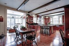 Traditional open kitchen with fireplace and sunroom | 47 Chartwell Road, Oakville