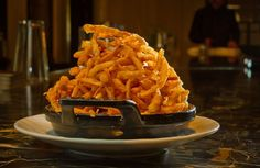 The spicy Onion Straws at Bourbon Steak restaurant in San Francisco, Calif., is seen on August 5th, 2011. Photo: John Storey, Special To The Chronicle