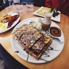 Photo of Gauffre Mignonne - Montreal, QC, Canada. Sugar rush pancake, egg ham cheese crepe, and side of eggs potatoes bacon