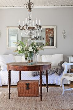 I love the soft wall color, chandelier, warm woods, natural rug
