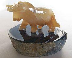 Tan onyx bull figurine on Thick blue polished Brazilian agate base New