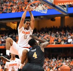 Syracuse basketball best dunks of 2014-15. Syracuse's Michael Gbinije follows up a missed shot with a dunk in the first half of the Syracuse-Long Beach State game