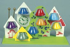 Bell House by TFH-UK. $49.00. Colorful toy which encourages gross motor skills. Mounted on a large plastic base is this charming little wooden village. The two included batons are about to shake things up a little. An early introduction to music-the bells are pleasant to hear.