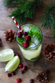 Christmas No-Jito made with Ginger Lemonade, Mint, cranberries, and other deliciousness.
