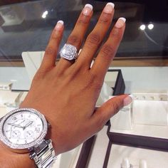 the michael kors watch is beautiful but look at the ring & her nails. gorgeous!