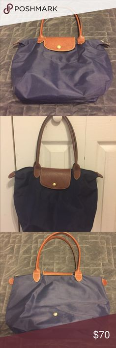 Longchamp small tote Beautiful Longchamp tote in navy. This is a re-posh. It is the small version of the tote. Please see the size in listing. ❌No trades or PayPal❌ Please submit all offers though the offer button. Longchamp Bags Totes