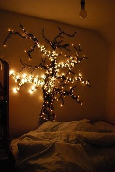 """Christmas lights can be added to just about any bedroom in your home to create a magical and cozy ambiance. I love the idea of a """"night light"""" or just for deco Diy Luz, Hanging Christmas Lights, Holiday Lights, Xmas Lights, Hanging Lights, Fairy Lights On Wall, Luminaire Led, Diy Casa, Tree Lighting"""