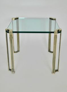 Pair of Hollywood Regency Polished Brass & Glass Side Tables by Peter Ghyczy   From a unique collection of antique and modern nesting tables and stacking tables at https://www.1stdibs.com/furniture/tables/nesting-tables-stacking-tables/