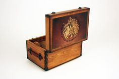 This wooden US Marshal Eagle Keepsake Box makes the perfect gift for our US Marshals. This box features  US Marshal in a bold block text on the front, a golden eagle with a brown leather background artwork on the top of the box, accented with decorative metal hardware, leather handles, and a plain tray. This US Marshal Eagle Keepsake Box is handcrafted in the USA and provides great storage for career memorabilia.WEIGHT – 18 lbsDIMENSIONS – Exterior : 18 x 12 x 10 Interior: 16 1/4 x 10 1/2 x 7Han Decorative Metal, Decorative Boxes, Us Marshals, Golden Eagle, Black Felt, Keepsake Boxes, Hope Chest, Leather Handle, Brown Leather
