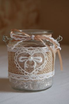 Hessian and lace covered tea light holder available for hire