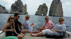 Drinking Prosecco at Faraglioni rocks, lovely day with a australian family on board of Enterprise'34. Booking your daily excursion in Capri. The paradise can be cheap ;) #dailyexcursioninCapri# #discovermanycaves# #amalficharterenjoywirhus# Visit us on  www.amalficharter.it