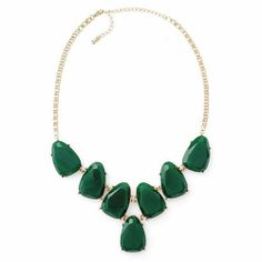 "EMERALD BAY NECKLACE + Green faceted resin stone necklace in ""V"" shape. Lobster claw clasp. 18"" + 4"" extender.35.00 Item: 12254 Y-E-S:  $15.00"