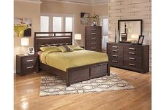 """The Aleydis Panel Bedroom Set from Ashley Furniture HomeStore (AFHS.com). With a warm brown finish flowing over the replicated oak grain perfectly complemented by the tufted faux leather upholstered headboard, the """"Aleydis"""" bedroom collection is a shining example of sleek Metro Modern design that is sure to enhance the décor of any home."""