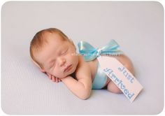 "The tag could also say, ""To: then the parents names"" or ""Gift from God"" or ""Special Delivery"" great newborn baby photo"
