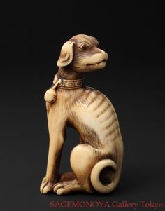 European Dog with collar and bell. Ivory Netsuke. signed TOMOTADA. 18th C. 唐犬 象牙刻 根付。 銘 友忠。
