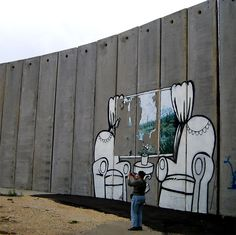 Graffiti by Banksy on the Wall - Bethlehem, West Bank.