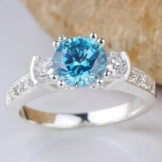 Exquisite Vibrant Silver Blue Topaz Ring Size. Starting at $10 on Tophatter.com!