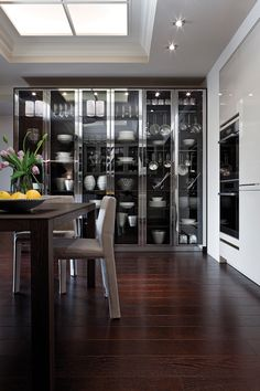 Polished chrome and glass cabinets provide a stunning storage solution. From SieMatic's Beaux Arts Collection.