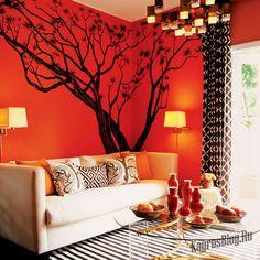 Как оформить гостиную в оранжевых тонах?