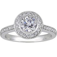 Round bezel halo diamond ring with side stones from Brilliant Earth. Just another special take on the halo!