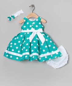 Complete with a lacy headband, silky-soft diaper cover and fancy frock that snaps in back, this charming ensemble makes getting dressed oh-so-easy. Tulle in the lining gives this pretty polka dot piece extra pouf.
