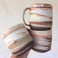 """Inspired by the layered desert landscape of Death Valley's Zabriskie Point, this mug is wheel-thrown with mixed high-fire clays, dipped in food-safe glaze and hand painted with matte metallic gold. Fired three times, this stoneware mug is ready for your favorite brew. Each one has slight variations due to it's hand made nature. Measures approximately 4.5"""" x 3.5"""" Made to order. Please allow approximately 8 weeks. Made by Sherise Lee - mother, artist / designer and exper..."""