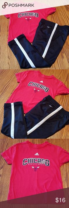 Adidas Chicago Bulls shirt and Everlast pants Boys sport set  ** Adidas Chicago Bulls shirt      *  Red with Bulls logo on chest      *  Size medium 5/6      *  Good condition   ** Everlast track pants      *  Size medium       *  Really good condition       *  2 side pockets      *  Black with white stripes  Open to offers!  Bundle for more savings! Adidas & Everlast Matching Sets