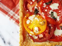 Heirloom tomato tart is a delicious, savory tart. It has a buttery, Parmesan crust and a juicy tomato filling. Perfect for brunch or a light lunch.