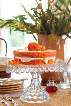 This tantalizing Honey Crème Fraîche Cake is decadently layered with Honey Crème Filling and crowned with Spiced Apricots.