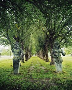 """Walk of the Old Gods"". Limestone Nordic gods guard the grounds of Häringe Slott, a hotel located on a nature reserve south of Stockholm, Sweden"