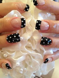Black polish with white polka dot nail art