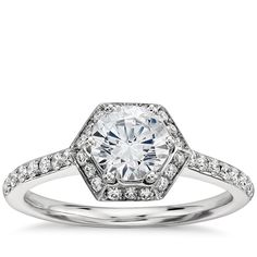 Brides.com: . Hexagon halo engagement ring in platinum with 1/2 CT round-cut center stone, approximately $3,700, Monique Lhuillier Fine Jewelry available at Blue Nile