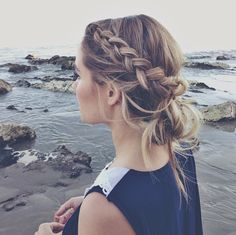 Check out this lovely braid, wrapped around like a crown above a loose bun, along with warm blonde highlights... We love it! Find out what style works for you at Beauty.com!
