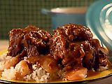 Jamaican oxtail stew!  Fell in love with this on vacation...might have to try it.  Now where in the hell will I find oxtail in MI?