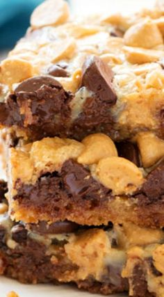 Five-ingredient Chocolate Peanut Butter Magic Bars ~ Rich and fudgy one pan dessert with sweetened condensed milk, a graham cracker crust and lots of chocolate and peanut butter chips... These cookie bars disappear quickly – like magic!