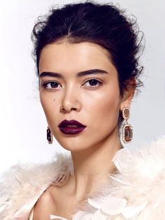 new kinda look im going 4; none- really light eye makeup, dark red lips. this model isn't doing this but red eyeshadow underneath the eye, really really long lashes.