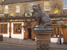 the statue of Greyfriars Bobby sits outside the nearby churchyard and the pub of the same name at the top of Candlemaker Row, Edinburgh- we had our pre wedding party here Places In Scotland, Scotland Uk, Edinburgh Scotland, Scotland Travel, Edinburgh Attractions, Greyfriars Bobby, Free Travel, Travel Uk, Love Statue