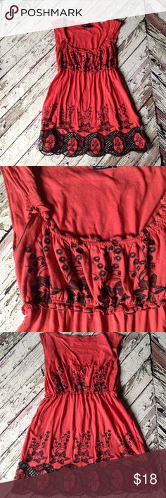 BCBG Maxazria peplum top with flower detail Red with black appliqué details. BCBGMaxAzria Tops