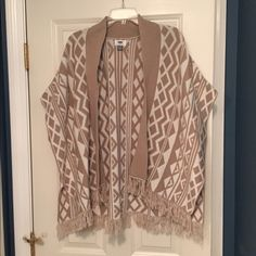 Old Navy sleeveless sweater cardigan NWT size XS/S Brand new with tags. Gorgeous design. NWT. I also have an M/L. See other listing. If you're a small medium, go for the XS/S. If you usually wear medium and larges, the M/L may be best. Old Navy Sweaters Shrugs & Ponchos