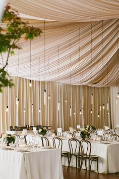 Chic unique wedding.  Love the peekaboo green tree from the side, hanging lights, and cool white look #loveatfirstlight