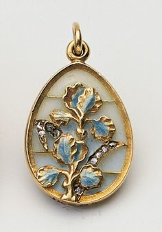 Fabergé Art Nouveau gold pendant decorated with irises, in pliqué-a-jour enamel set with rose diamonds, c. 1900. Acquired by Queen Alexandra, date unknown.