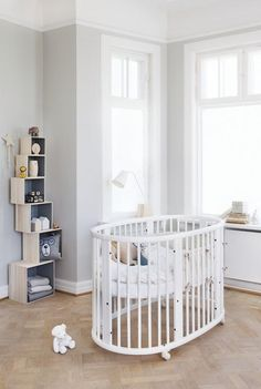 Made from durable solid beech wood with height adjustable mattress bottom that makes lifting your child in and out easier – Stokke Sleepi Crib in White
